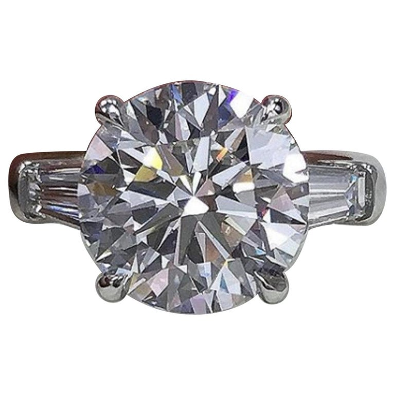 GIA Certified 5.65 Carat Round Brilliant Cut Tapered Baguettes Diamond Ring  For Sale