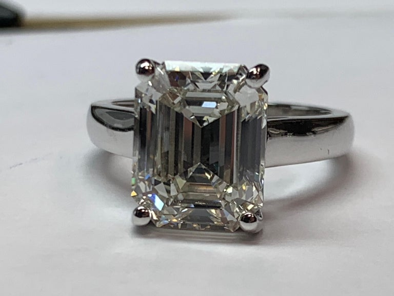 Women's GIA Certified 5.60 Carat Natural Emerald Cut Diamond I VS1 None Engagement Ring For Sale