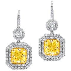 GIA Certified 5.63 Carat Canary Yellow Diamond Earrings
