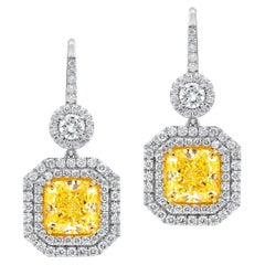 GIA Certified 5.63 Carat Canary Yellow Diamond Earrings