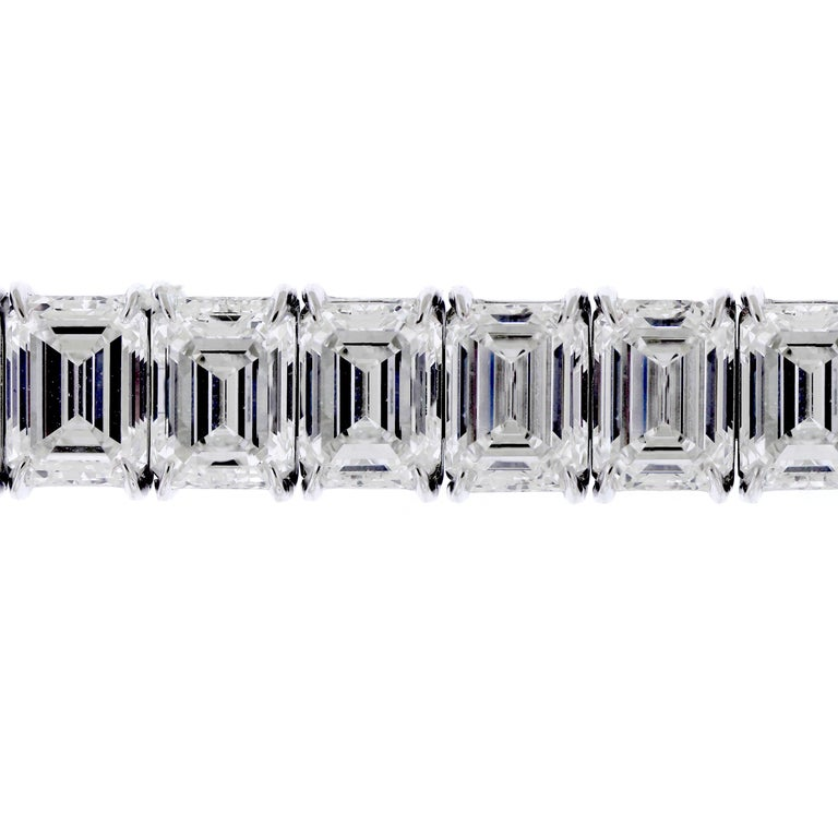 GIA Certified 56.62 Carat Emerald Cut Diamond Tennis Bracelet.   Diamonds: Apprx. 56.62 carat Emerald Cut diamonds. Diamonds are H/I in color and VS2-VVS1 in clarity.  28 Emerald Cut Diamonds total. Diamonds average 2 carat each.  Each single