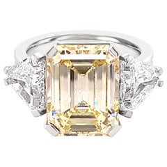 GIA Certified, 5.73K Light Yellow Diamond 2.3K White Diamond Trilliant Cut Ring