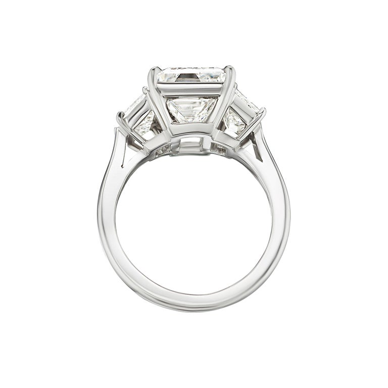 Antinori Fine Jewels is proud to offer this important and impressive 5.75 carat GIA certified Emerald cut diamond ring.  Set in 18 carats white gold mounting. Certified by GIA the main stone weights 5 carats and is totally eye clean and white