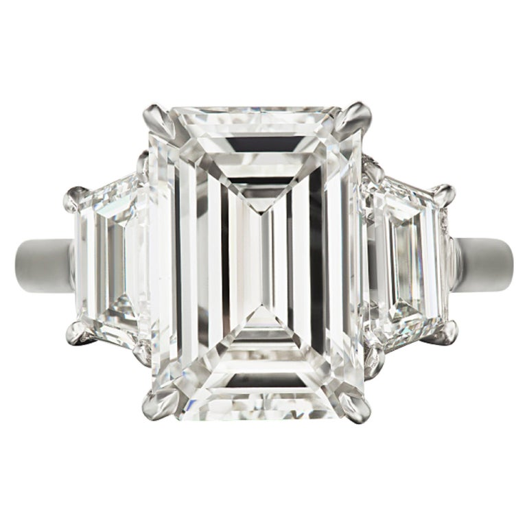 GIA Certified 5 Carat Emerald Cut Three Stone Engagement Ring For Sale