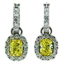 GIA Certified 5.86 Carat Fancy Intense Yellow or VS2 Diamond Earrings
