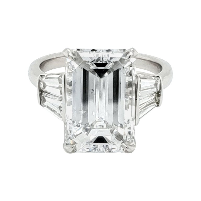 GIA Certified 6 Carat Emerald Cut Diamond and Tapered Baguette Diamond Plat Ring For Sale