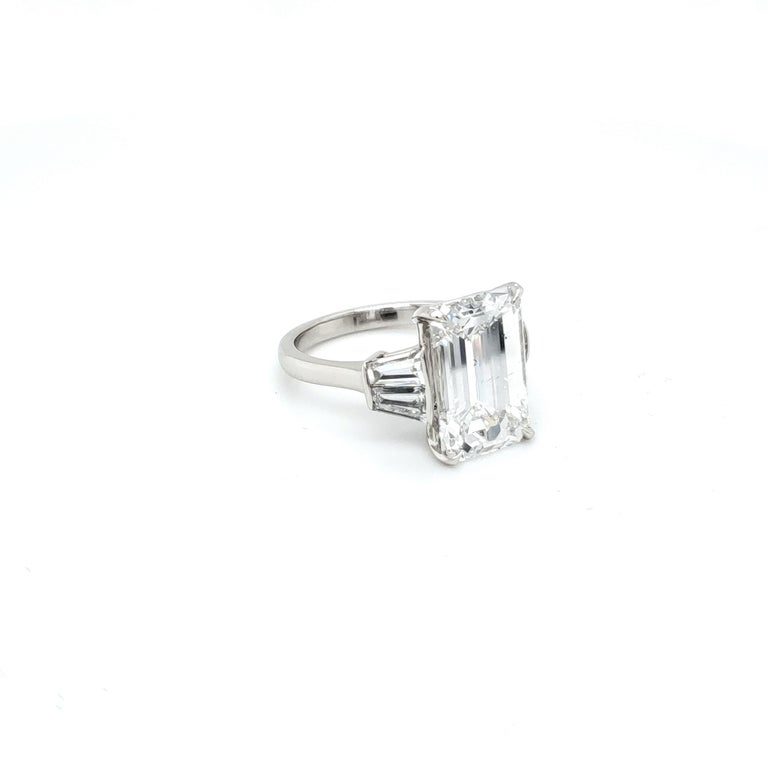 GIA Certified 6.03 carat Diamond with an emerald cut set in four pointed prongs. The center diamond is accompanied by a GIA certificate, diamond report. The GIA report number is 5202555415. The diamond is F color and SI-1 clarity. VERY white