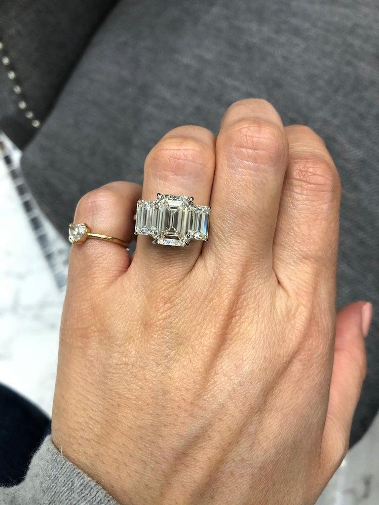Modern GIA Certified 7 Carat Engagement Three Stone Emerald Cut Diamond Platinum Ring For Sale