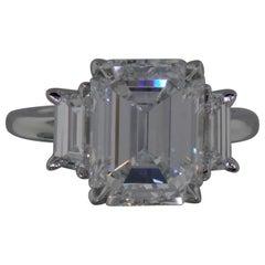 GIA Certified 5 Carat Three-Stone Emerald Cut Diamond Ring