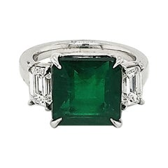 GIA Certified 6.00 Carat Emerald & 1.00 Carat Diamond Platinum Three-Stone Ring
