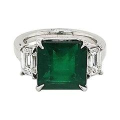 GIA Certified 6.00 Carat Emerald & 1.00 Carat Diamond Platinum Three-Stone Ring