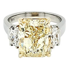GIA Certified 6.02 Carat Fancy Yellow Radiant Cut Diamond Three-Stone Ring