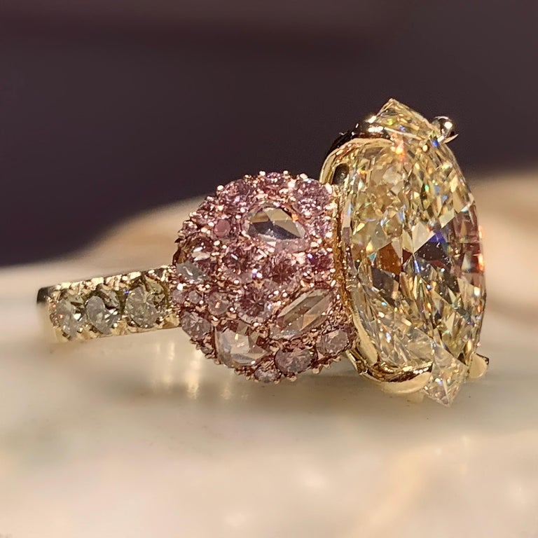 One of a kind ring in 18K Yellow & Rose gold 10,8 g. Set with a GIA Certified Fancy Light Yellow, VS2, 6,02 ct. Marquise shape diamond centerstone, pave set Fancy Pink brilliant-cut diamonds 0,795 ct. Fancy Pink rose-cut diamonds 0,68 ct., Fancy