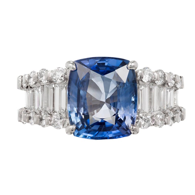 1950-1960 Estate bright blue 6.03 carat cushion cut GIA certified natural sapphire and diamond engagement ring. Platinum setting with a Simple heat, no other enhancement sapphire with emerald and round cut diamond accents.   1 cushion cut blue