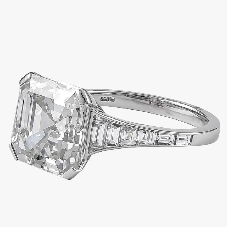 GIA certified 6.06 carat emerald cut center diamond surrounded with gorgeous small diamonds with the total weight of 0.72 carat engagement ring.
