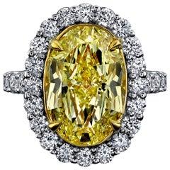 GIA Certified 6.08 Carat, Oval Cut, Fancy Intense Yellow Diamond Ring