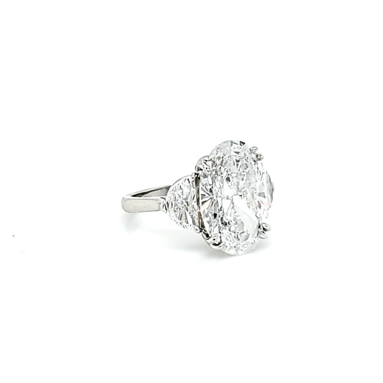 Women's GIA Certified 6.16 Carat Oval Cut Diamond Three-Stone Ring For Sale