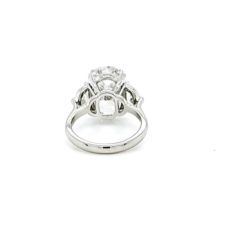 GIA Certified 6.16 Carat Oval Cut Diamond Three-Stone Ring For Sale 2