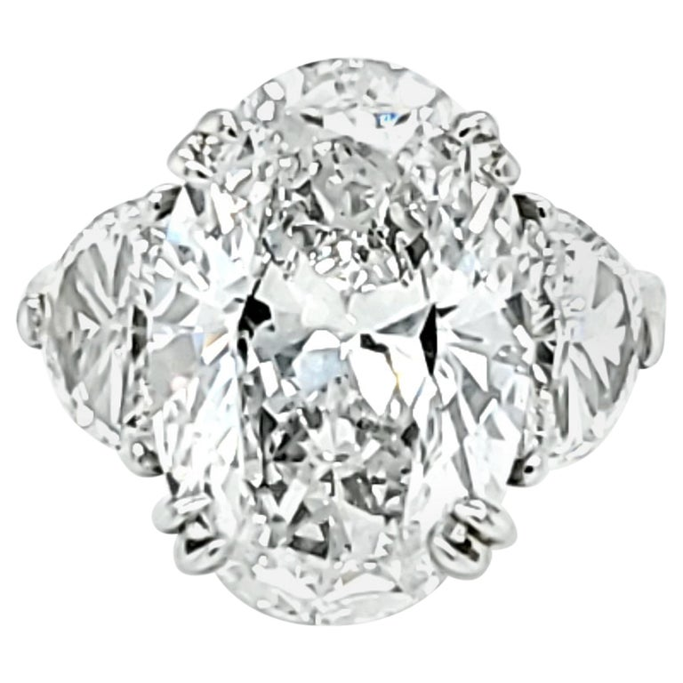 GIA Certified 6.16 Carat Oval Cut Diamond Three-Stone Ring For Sale