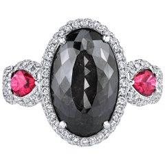 GIA Certified 6.21 Carat Oval Fancy Black Diamond with 2 Rubies