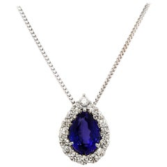 GIA Certified 6.26 Carat Pear Shaped Tanzanite Necklace with 1.20 Carat Diamonds