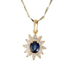 GIA Certified .63 Carat Sapphire Diamond Halo Yellow Gold Pendant