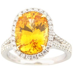 GIA Certified 6.34 Carat Yellow Sapphire and Diamond Cocktail Ring