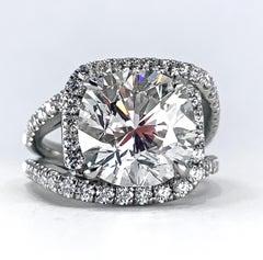 GIA Certified 6.44 Carat Cushion Cut Diamond in Updated Platinum Halo Ring