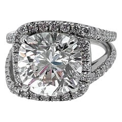 Updated Halo Ring with GIA Certified 6.44 Carat Cushion Cut Diamond in Platinum