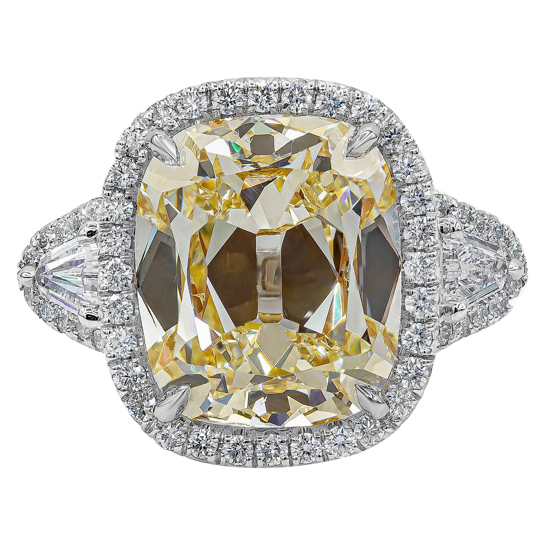 GIA Certified 6.47 Carat Cushion Yellow Diamond Three-Stone Halo Engagement Ring