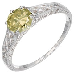 GIA Certified .65 Carat Yellow Diamond White Gold Engagement Ring