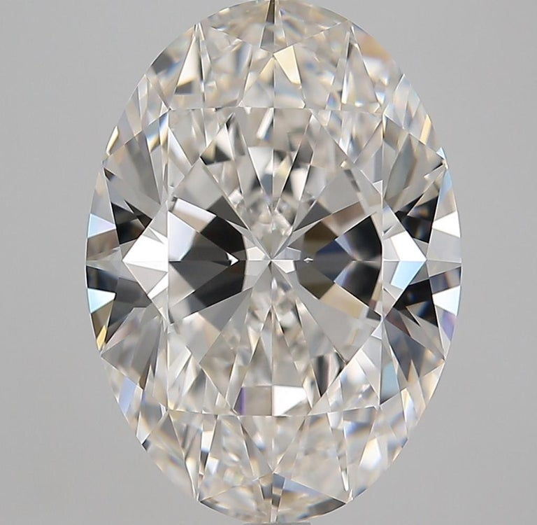 Gia certified oval diamond the main stone weights 6 carats  I (totally white faced) a high I color  vs2