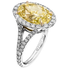 GIA Certified 6.54 Carat Oval Fancy Yellow Diamond Ring