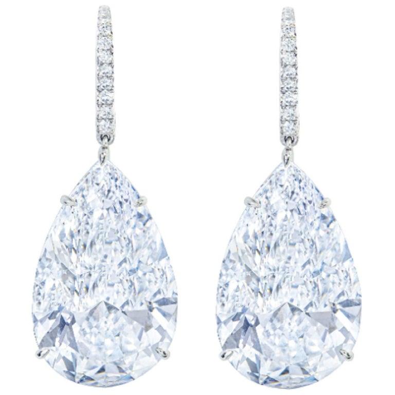 GIA Certified 6.81 Carat Pear Cut Diamond Dangle Earrings For Sale