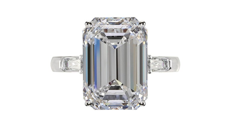 Amazing emerald cut diamond ring the main stone is an exquisite 6.40 carat emerald cut diamond with E color and VS1 clarity plus triple excellent cut without fluorescence.  the side diamonds are tapered baguette and very pure   mounted in solid 950