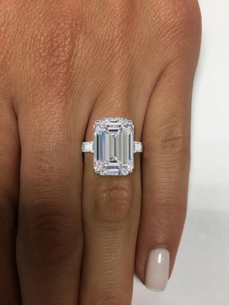 Modern GIA Certified 7 Carat Emerald Cut Diamond Ring VS1 E Color For Sale