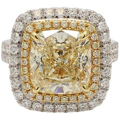 GIA Certified 7.04cts Natural Yellow Cushion Diamond in a 18k Gold Ring 8.28tw
