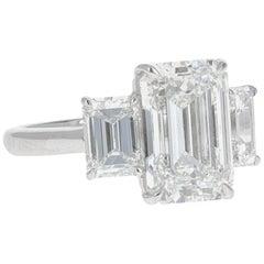 GIA Certified, 7.14 Carat Three-Stone Emerald Cut Diamond Ring