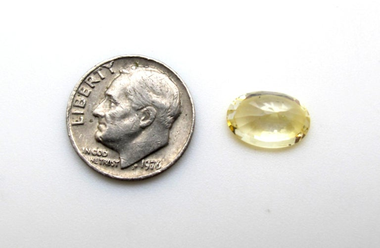 Artisan GIA Certified 7.16 Carat Unheated Yellow Sapphire Loose Gemstone For Sale