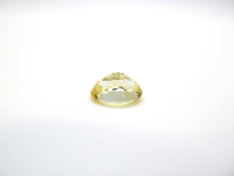 Oval Cut GIA Certified 7.16 Carat Unheated Yellow Sapphire Loose Gemstone For Sale