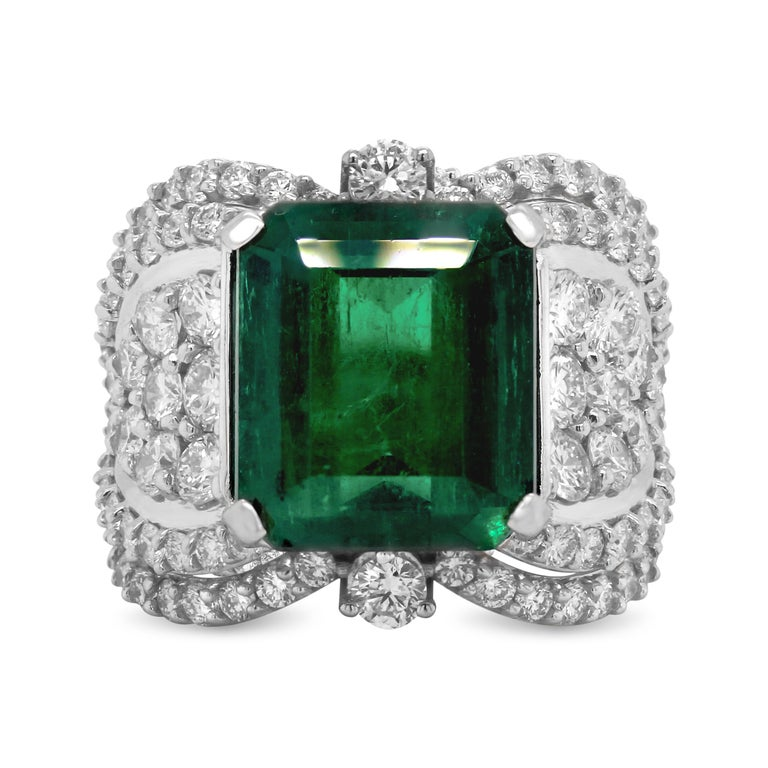GIA Certified 7.25 Carat Colombian Emerald 18K White Gold Diamond Cocktail Ring   This one-of-a-kind ring features a 7.25 carat natural Colombian Emerald that is an octagonal cut. GIA certificate states the Emerald is moderate clarity enhanced which