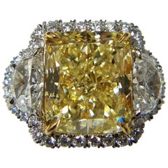 GIA Certified 7.41 Carat Cushion Cut Natural Fancy Yellow Ring by Louis Newman