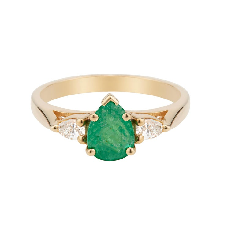 1960's Emerald and diamond engagement ring. GIA certified pear shaped emerald center stone in a 14k yellow gold three-stone setting with 2 pear shaped side diamonds.    1 pear shaped green Emerald, approx. total weight .75cts, I, 8.0 x 5.84 x