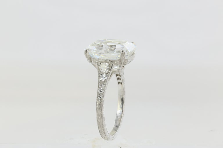 Platinum solitaire engagement ring featuring one Asscher cut Diamond, weighing 7.51 carats with a color and clarity of F/VS1; accompanied with GIA certified #2171902464. Custom platinum tapered mounting set with round brilliant cut diamonds with
