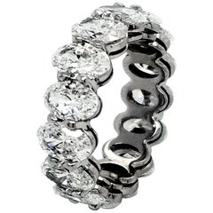 GIA Certified 7.61 Carat '1/2s' Oval Platinum Diamond Eternity Ring