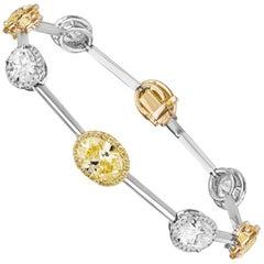GIA Certified 7.61 Carat Fancy Vivid Yellow and White Oval Diamond Bracelet