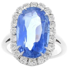 GIA Certified 7.66 Carat Unheated Oval Blue Sapphire and Diamond Cocktail Ring
