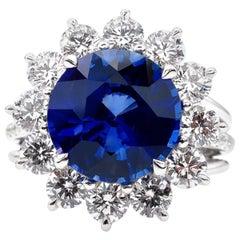 GIA Certified 7.73 Carat Ceylon Royal Blue Sapphire Round Cut Diamond Ring