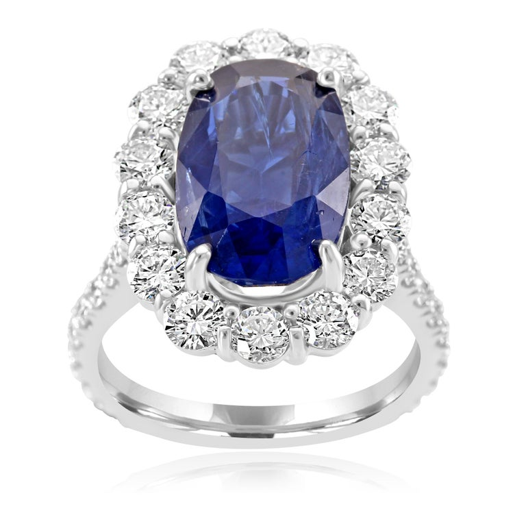 For the collector, rare 7.85 carat gem oval Blue sapphire. The sapphire is accompanied by GIA report stating the country of origin as Burma and and that there is no indication of heat treatment. Center Sapphire is encircled in a single halo of white