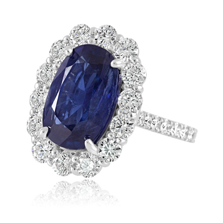 Modern GIA Certified 7.85 Carat No Heat Burma Sapphire Diamond Halo White Gold Ring For Sale